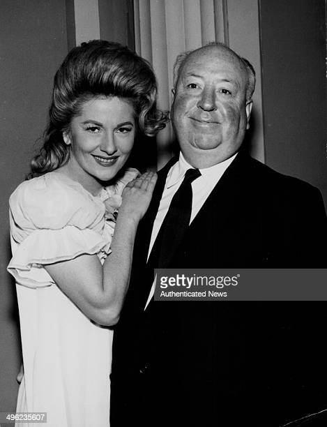 Portrait of director Alfred Hitchcock and actress Joan Fontaine on the set of 'The Alfred Hitchcock Hour Salt of the Earth' circa 19621965