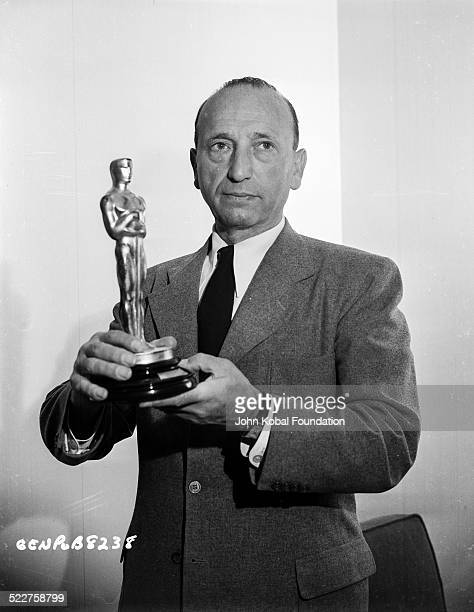 Portrait of director Michael Curtiz holding his Academy Award for his film 'Casablana' with Warner Brothers Studios 1944