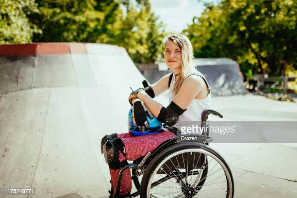 Portrait of disabled woman in wheelchair in skate park