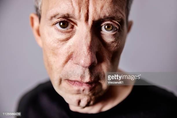 portrait of disappointed mature man - starren stock-fotos und bilder