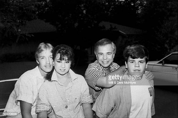 Portrait of disgraced PTL evangelist Jim Bakker outside w soninlaw Doug Chapman daughter Tammy Sue and son Jamie Charles on the family's day in their...