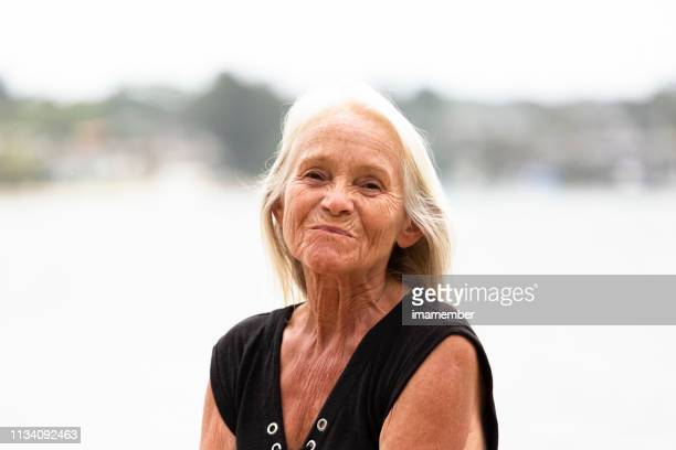 portrait of disguste old woman, outdoor, background with copy space - inconvenience stock pictures, royalty-free photos & images