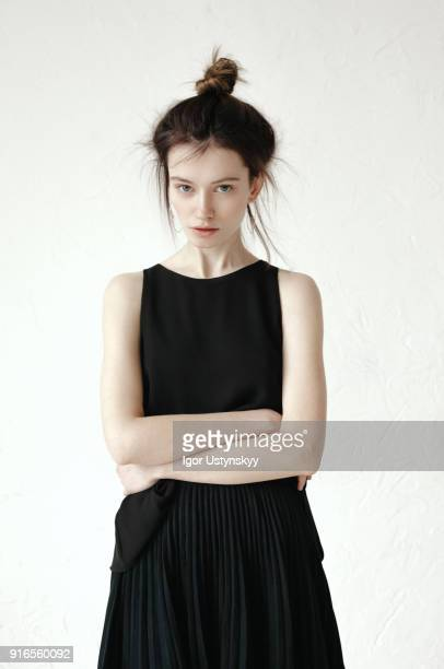Portrait of disgusted woman standing with hands folded