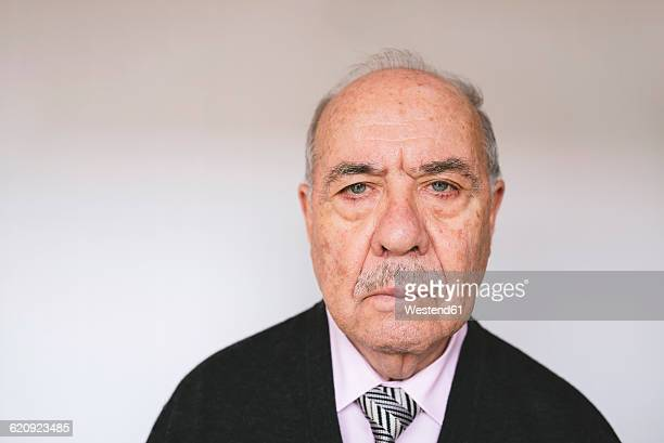 Portrait of displeased senior man