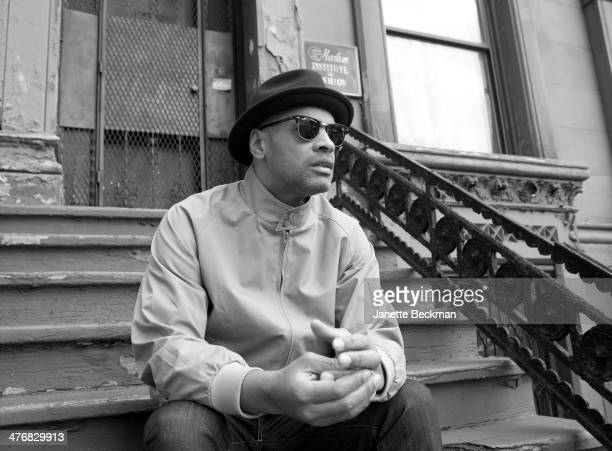 Portrait of DJ Nature as he sits on a stoop in Harlem New York New York December 11 2012