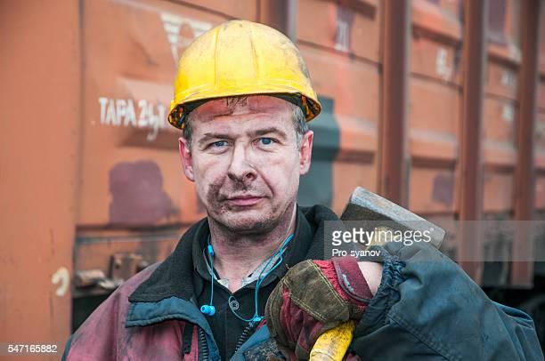Portrait of docker  at the coal termina