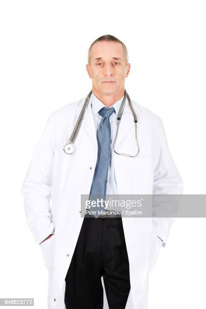 Portrait Of Doctor Against White Background