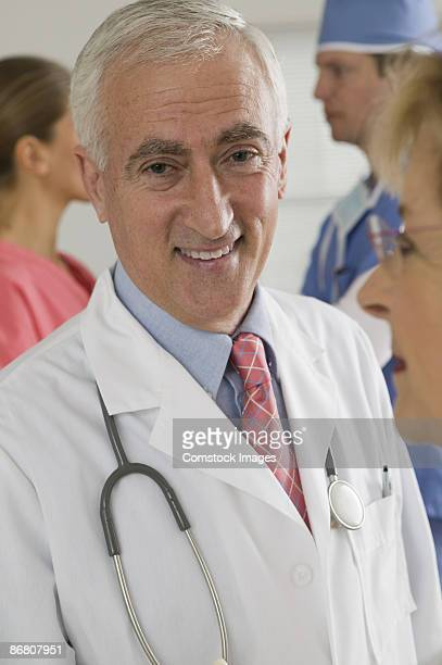 portrait of doctor among others - category:cs1_maint:_others stock pictures, royalty-free photos & images
