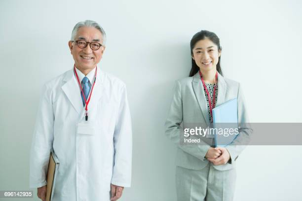 Portrait of doctor and businesswoman