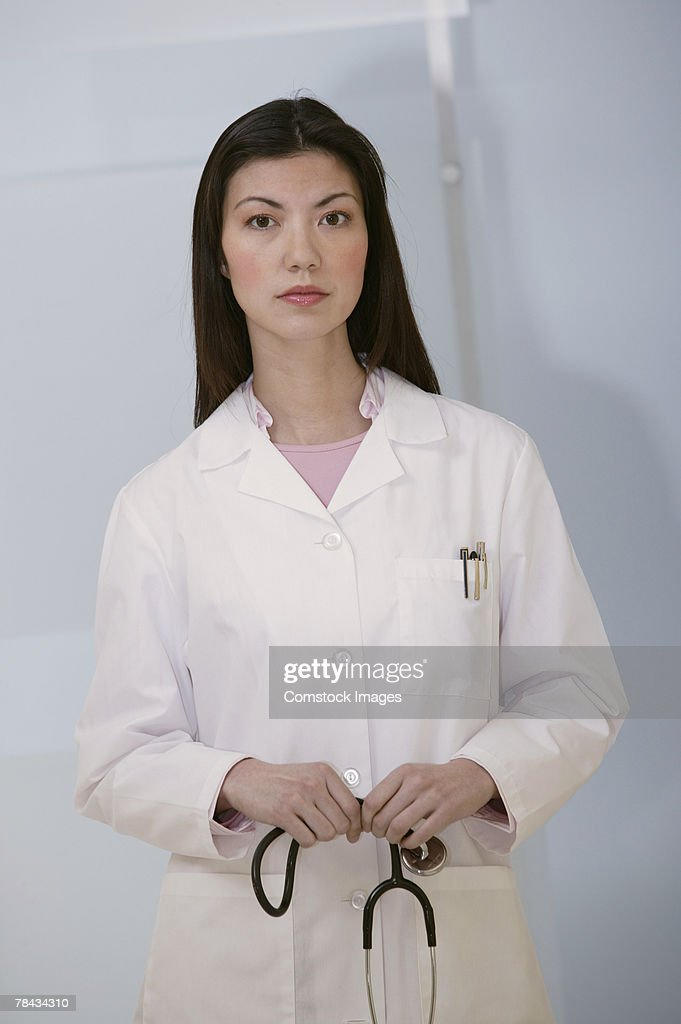 Portrait of doctor holding stethoscope : Foto de stock