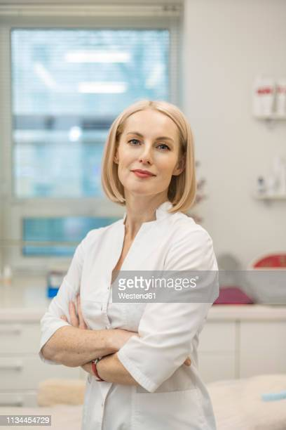portrait of doctor in beauty clinic - beautician stock pictures, royalty-free photos & images