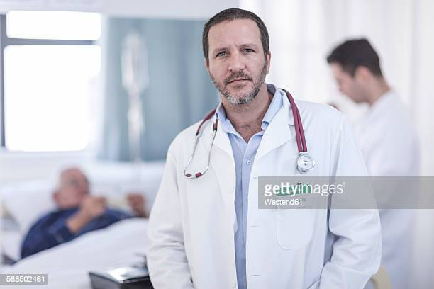 portrait of doctor in hospital - nameplate stock pictures, royalty-free photos & images