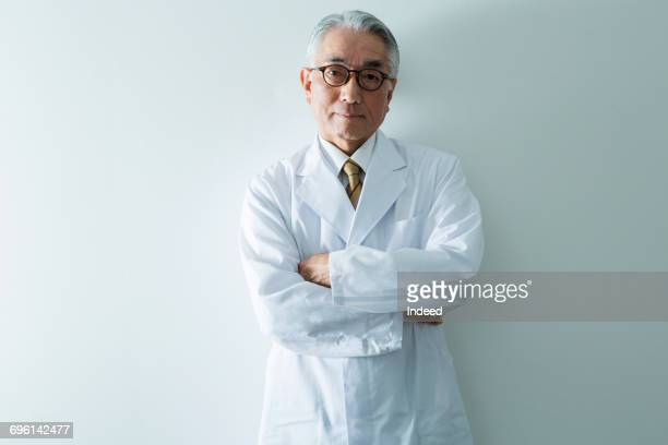 portrait of doctor  - waist up stock pictures, royalty-free photos & images