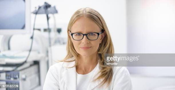 portrait of doctor - part of a series stock pictures, royalty-free photos & images