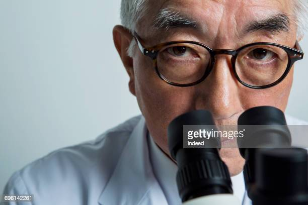 Portrait of doctor with microscope
