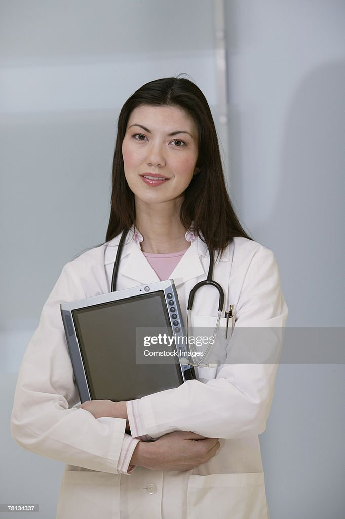 Portrait of doctor with tablet pc : Stockfoto