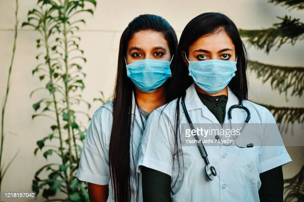 portrait of doctors wearing mask at hospital - india stock pictures, royalty-free photos & images