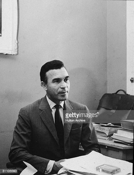 Portrait of Dominican diplomat and socialite Porfirio Rubirosa as he sits at his desk 1950s