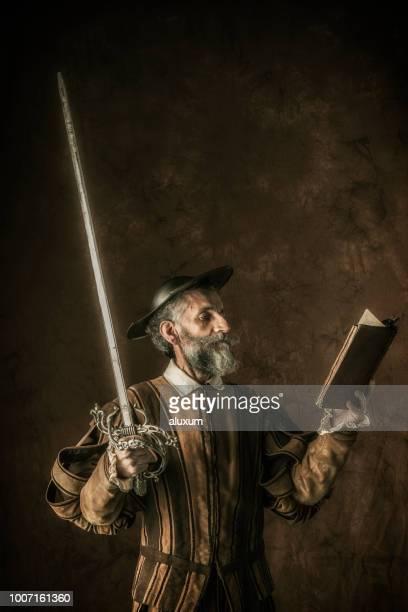 Retrato de Don Quijote con la espada y caballerías novela en sus manos