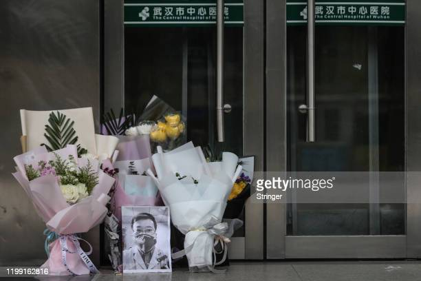 A portrait of Dr Li Wenliang is left at Li's hospital in Wuhan on February 072020 in WuhanHubei provinceChina Dr Li regarded a whistleblower on the...