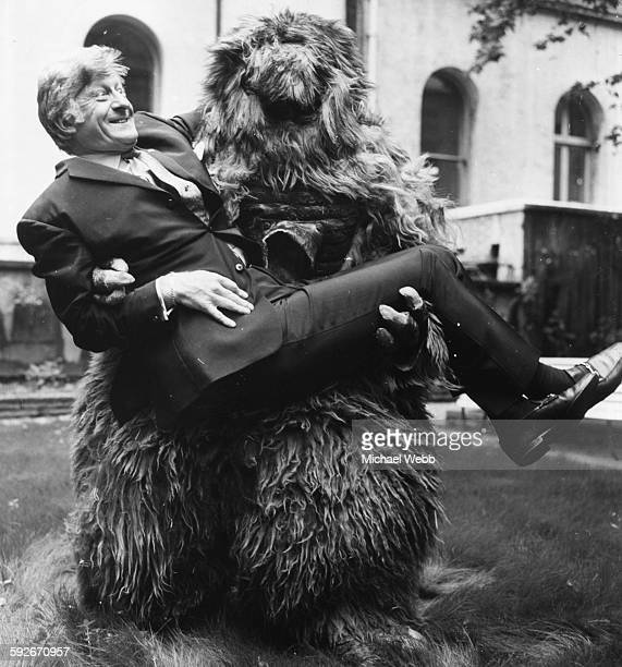 Portrait of 'Dr Who' actor Jon Pertwee being carried by one of the monsters from his television show at BBC Television Centre in London June 20th 1969
