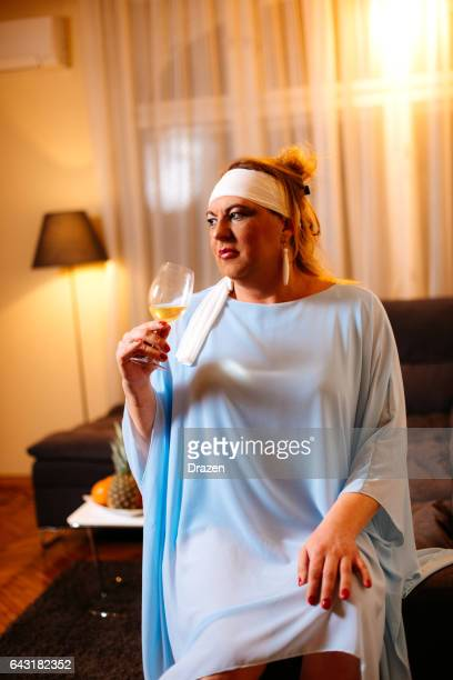 Portrait of drag queen in light blue dress - transsexual person at home