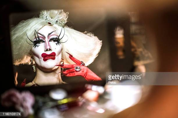 portrait of drag queen in red dress - transvestite stock photos and pictures