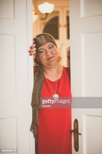 Portrait of drag queen in red dress - transsexual person at home