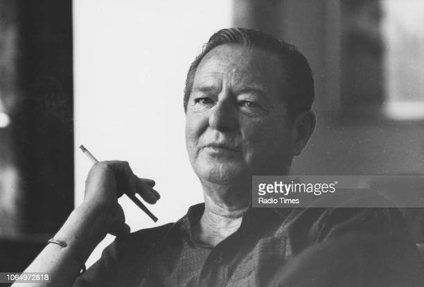 Portrait of dramatist Terence Rattigan smoking a cigarette, photographed for Radio Times in connection with the BBC screening of his film 'The...