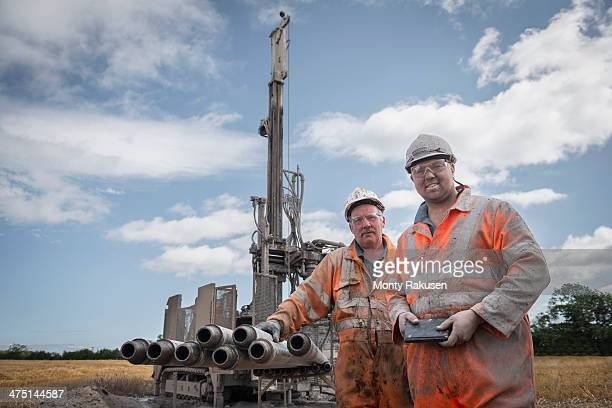 portrait of drilling rig workers in hard hats and workwear - モーペス ストックフォトと画像