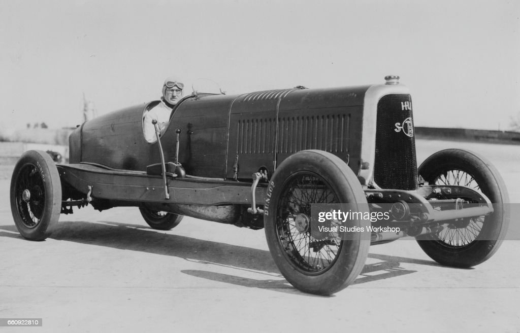 Portrait of driver GET Eyston as he sits in a Panhard race car ...