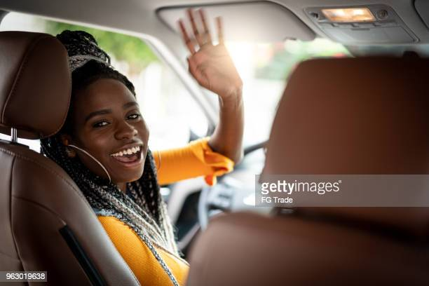 portrait of driver saying goodbye/hello to his passenger - taxi driver stock photos and pictures