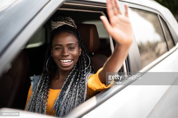 portrait of driver saying goodbye/hello to his passenger - waving stock pictures, royalty-free photos & images