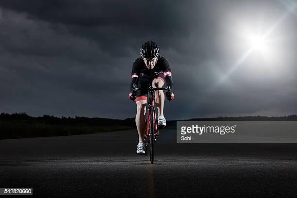 Portrait of driving racer biker