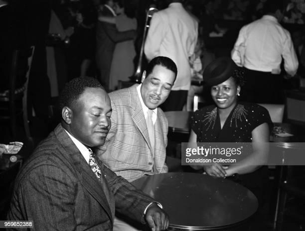 Portrait of Duke Ellington portrait at a table between 1938 and 1948.