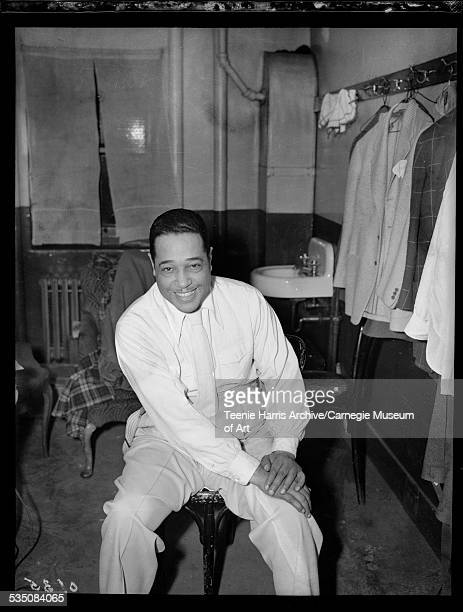 Portrait of Duke Ellington posed seated on a bentwood chair, Pittsburgh, Pennsylvania, March 1957.