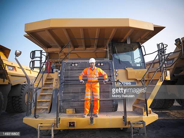 Portrait of dumper truck driver in opencast coalmine