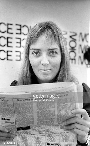 Portrait of Dutch brothelowner and madam Xaviera Hollander as she reads a paper in the offices of the Village Voice New York New York January 8 1972