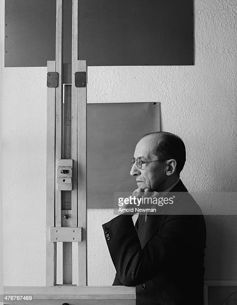 Portrait of Dutch painter Piet Mondrian as he leans on his easel New York New York January 17 1942