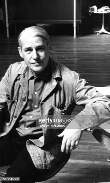 Portrait of Dutchborn American artist Willem de Kooning as he sits at his desk in his loft studio New York New York March 23 1962