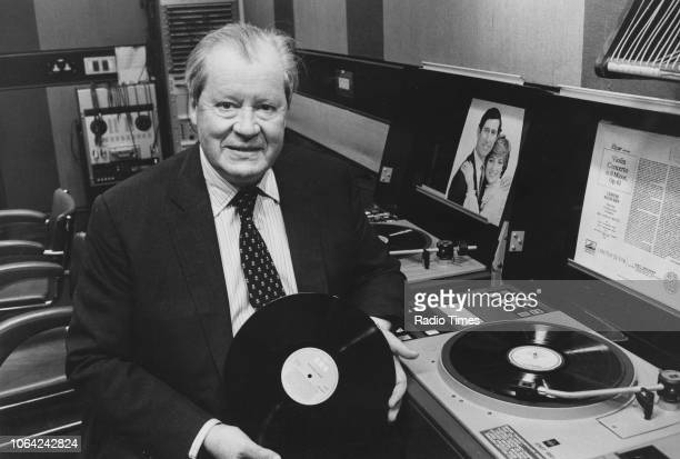 Portrait of Earl John Spencer father of Princess Diana playing records in a studio photographed for Radio Times in connection with his appearance on...