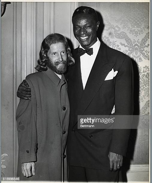 Portrait of Eden Ahbez composer of Nature Boy standing arminarm with his good friend and admirer Nat King Cole who made the first and best recording...