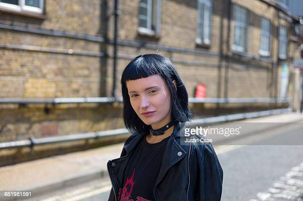 Portrait of edgy woman on a warehouse street