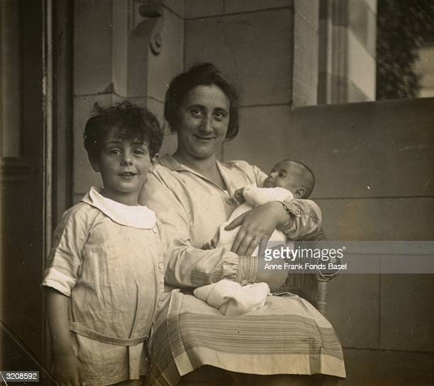 Portrait of Edith Frank mother of Anne Frank holding her infant daughter Margot sitting next to her nephew Elias Frankfurt am Main Germany Taken from...