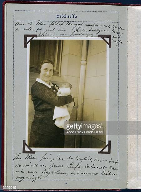 Portrait of Edith Frank the mother of Anne Frank holding her infant daughter Margot with a note about them arriving from a night train ride taken...