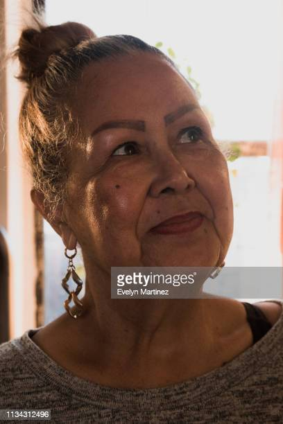 portrait of elder latina woman looking off to the side - evelyn martinez stock pictures, royalty-free photos & images