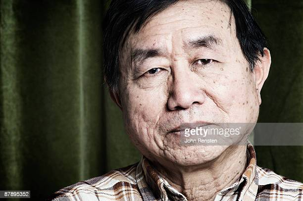 portrait of elderly chinese man - chinese ethnicity stock pictures, royalty-free photos & images