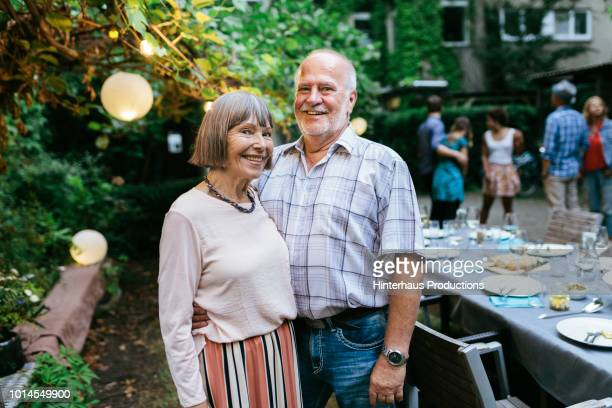 portrait of elderly couple at family bbq - disruptaging stock pictures, royalty-free photos & images