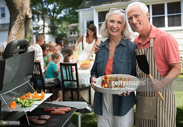 Portrait of elderly couple at the grill