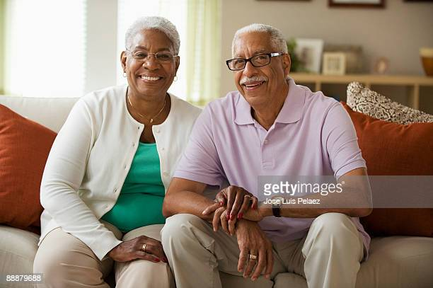 portrait of elderly couple - hand on knee stock pictures, royalty-free photos & images
